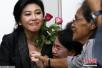 """泰国防长:监控拍到英拉乘车从军事检查站""""逃离"""""""