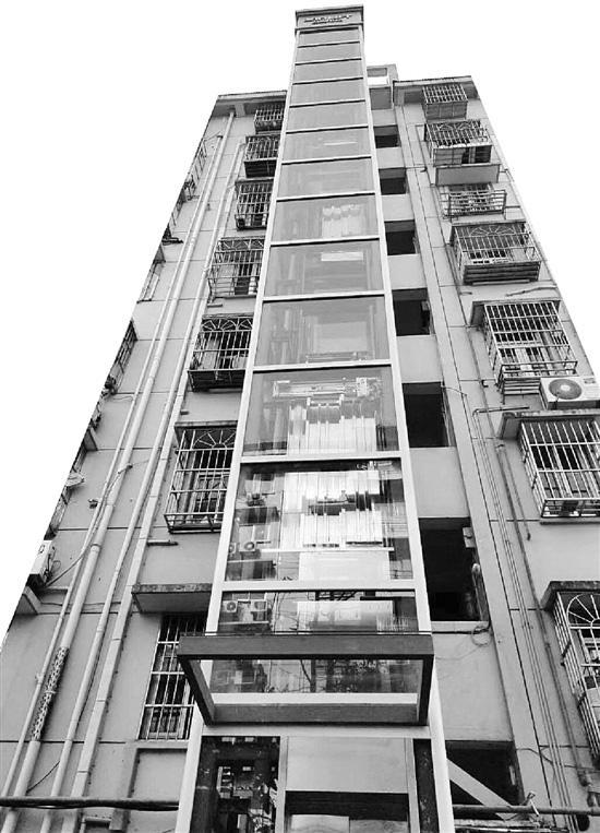 新加坡金沙赌场:杭州又一90年代楼栋加装电梯昨天启用,系全透明玻璃观景款