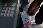 委内瑞拉力战恶性通货膨胀 四板斧能否挽狂澜