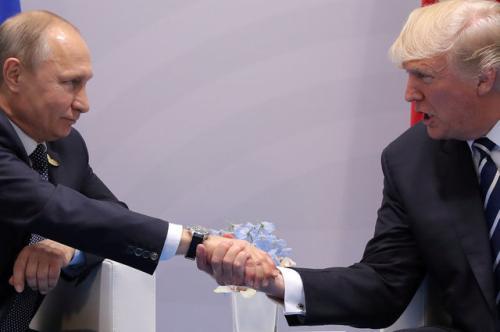 汉堡/资料图:普京与特朗普会晤。(图片来源:路透社)