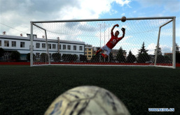 Students have fun playing football across China